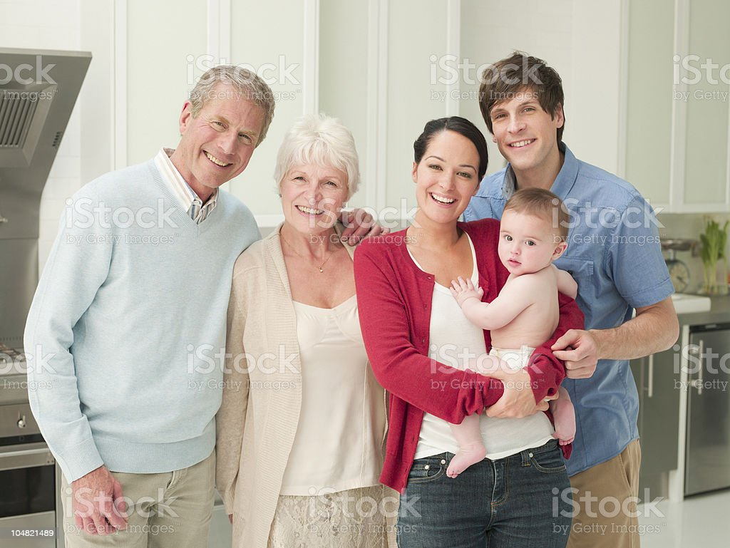 Smiling multi-generation family in kitchen stock photo