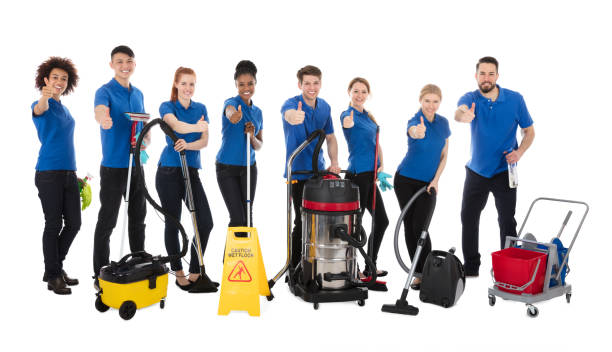 Smiling Multiracial Janitors Gesturing Thumbs Up Smiling Multiracial Janitors Gesturing Thumbs Up Over White Background cleaning equipment stock pictures, royalty-free photos & images