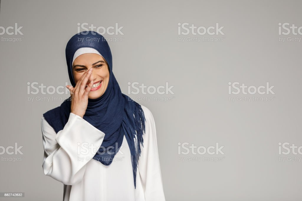 Smiling Muslim Woman Wearing Hijab stock photo