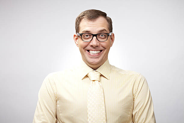 smiling nerd - nerd stock photos and pictures