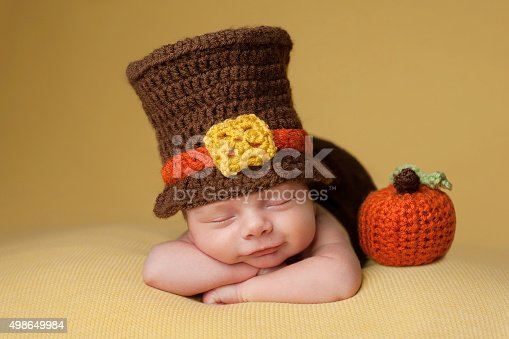 istock Smiling Newborn Baby Boy Wearing a Pilgrim Hat 498649984