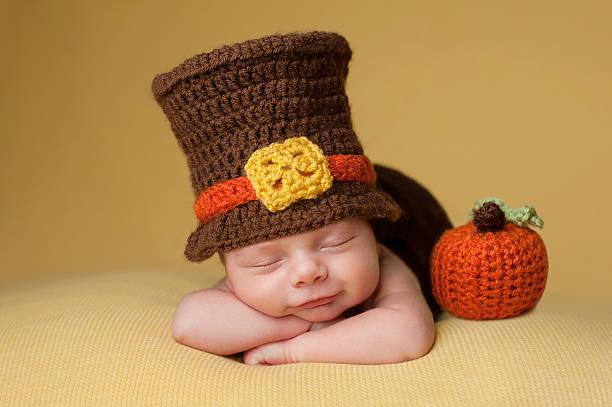 Smiling Newborn Baby Boy Wearing a Pilgrim Hat stock photo
