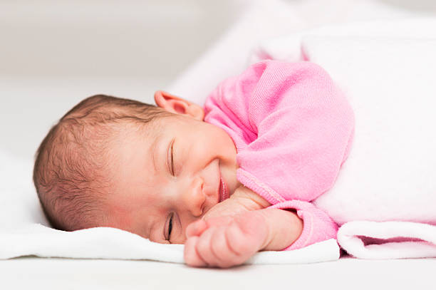 smiling newborn baby girl - newborn baby girl stock photos and pictures