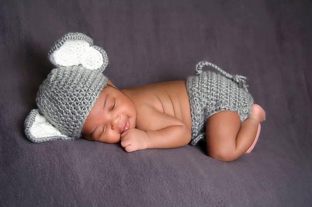 Smiling Newborn Wearing an Elephant Costume stock photo