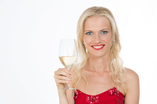 674214372 istock photo smiling nordic girl holding a glass of white wine 529724045