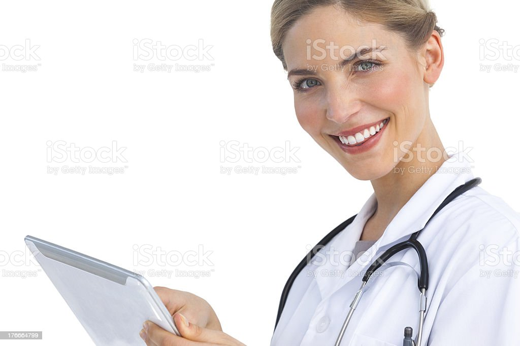 Smiling nurse with tablet pc royalty-free stock photo