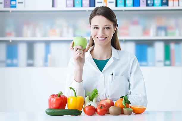 Smiling nutritionist in her office stock photo