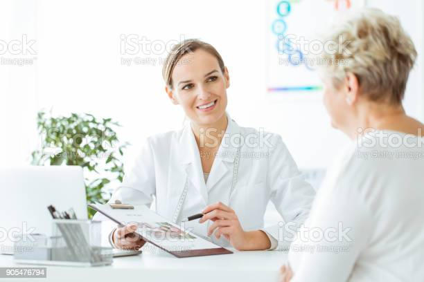 Smiling Nutritionist Showing Healthy Diet Stock Photo - Download Image Now