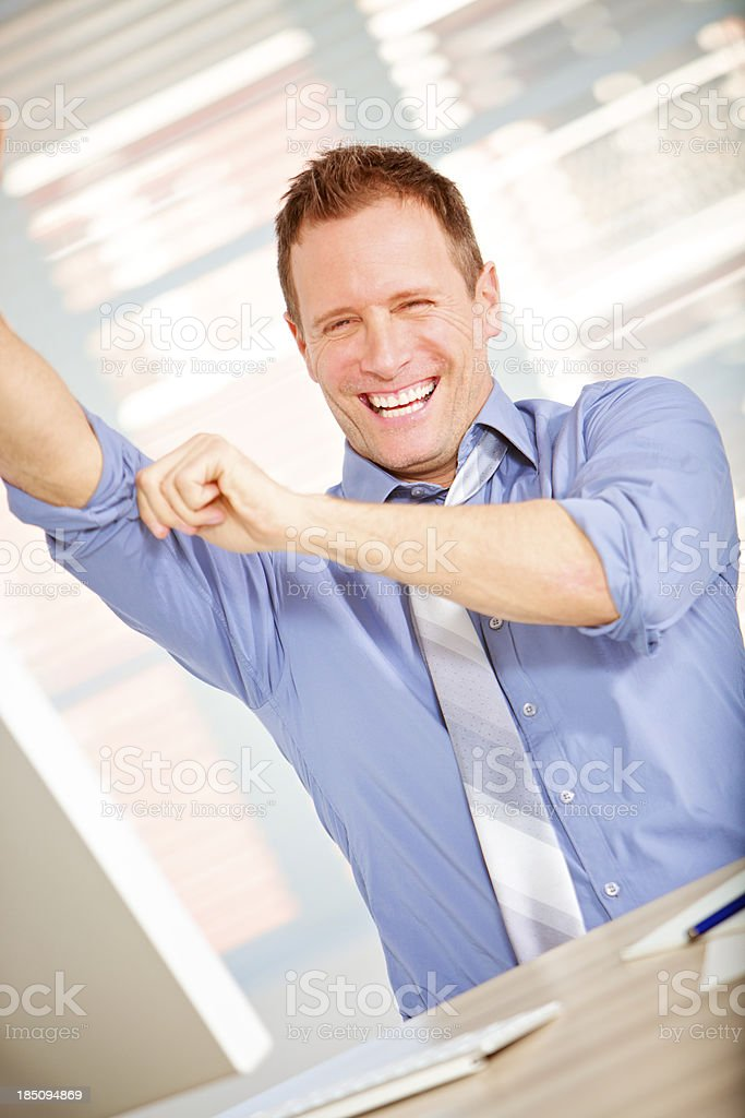 smiling Office worker rolling up sleeves stock photo