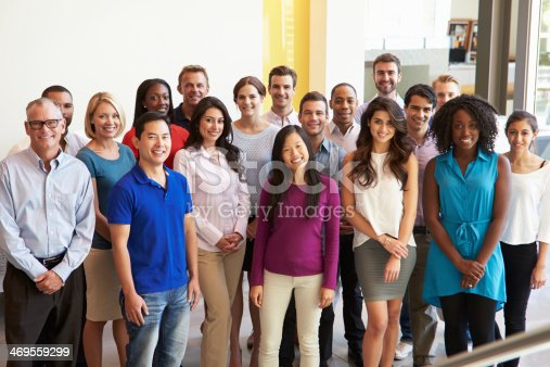 istock Smiling office workers pose for a group photo 469559299