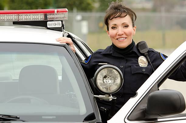 uśmiech officer - policja zdjęcia i obrazy z banku zdjęć