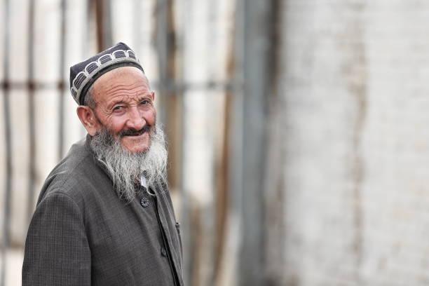 Lächelnd alter Mann des uigurischen Volkes. Sonntag Markt Bereich Hotan-Xinjiang-China-0135 – Foto