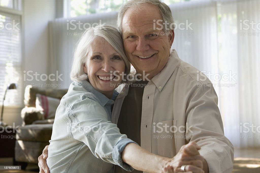 Smiling older couple dancing stock photo
