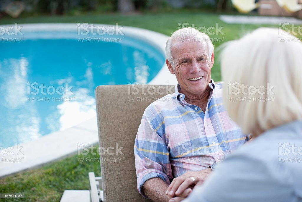 Smiling older couple relaxing outdoors royalty-free stock photo