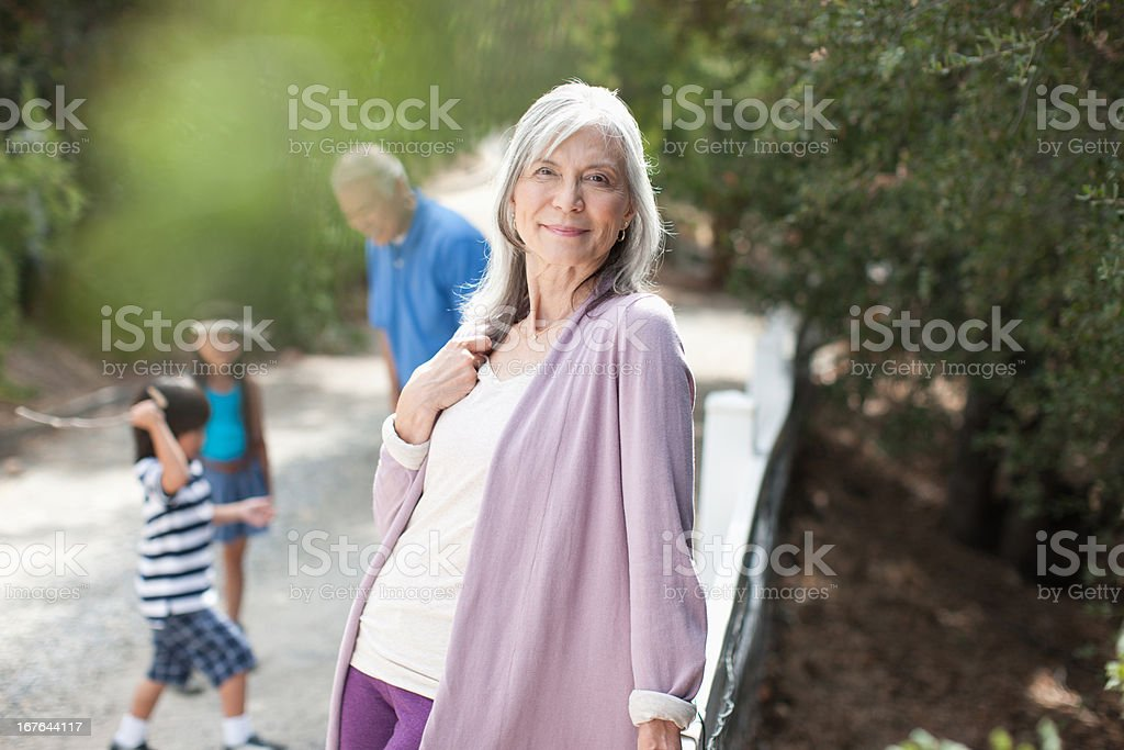 Smiling older woman standing outdoors royalty-free stock photo