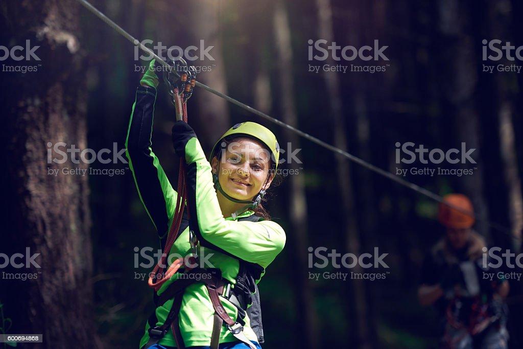 smiling on my zip lining adventure stock photo