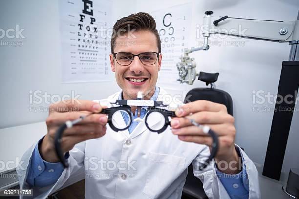 Smiling optometrist holding messbrille picture id636214758?b=1&k=6&m=636214758&s=612x612&h=nvxfacfxhtdf sktfmxyf3rckld7hmmxuxdxkomwksw=