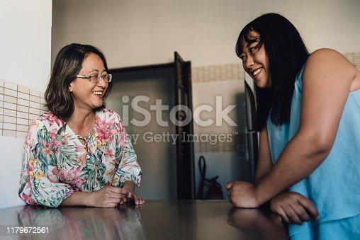 Smiling oriental women in the kitchen