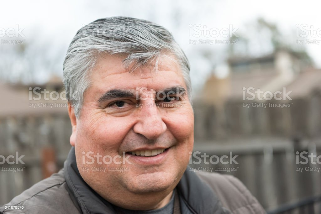 Smiling overweight man stock photo