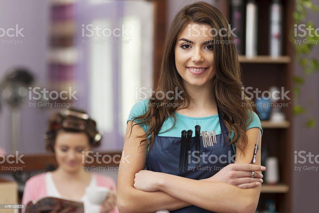 Smiling owner of hairdresser salon stock photo