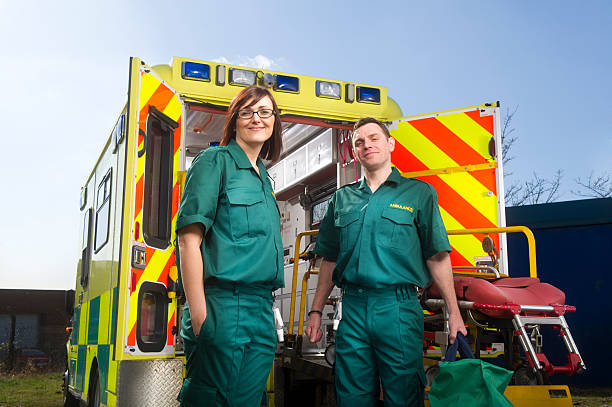 Smiling paramedics Paramedics smile to camera ambulance staff stock pictures, royalty-free photos & images