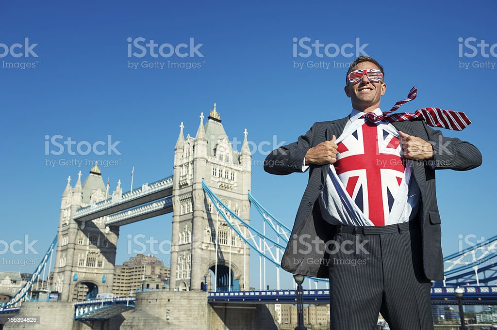 Smiling Patriotic British Businessman Superhero Union Jack Tower Bridge London royalty-free stock photo