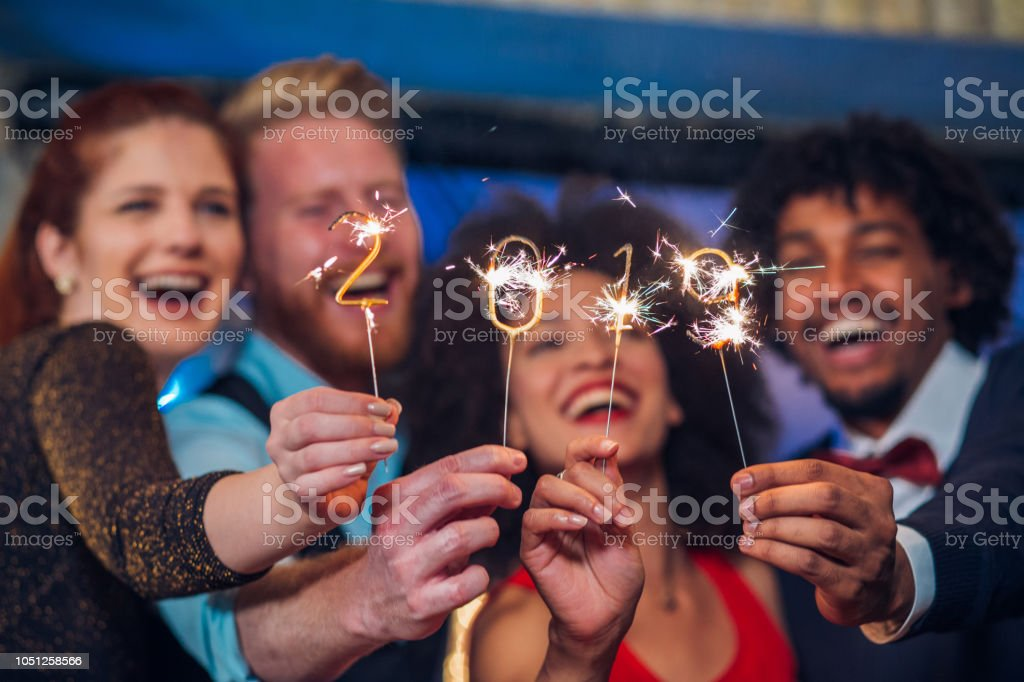 Smiling people holding sparklers stock photo