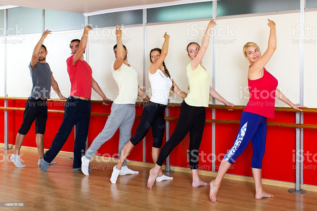 Smiling people rehearsing ballet dance stock photo
