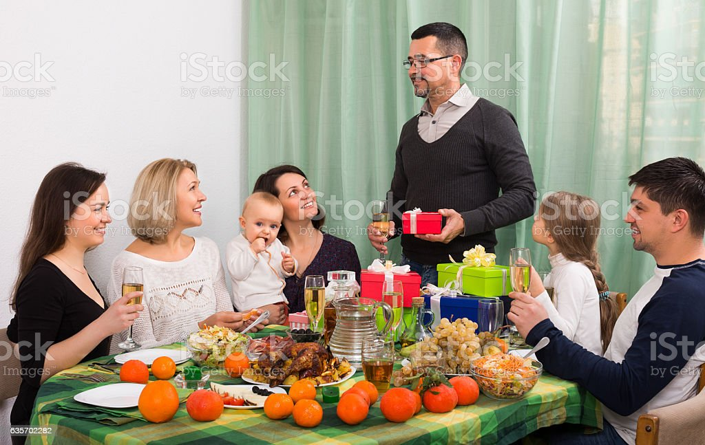 smiling person celebrating jubilee at  table royalty-free stock photo