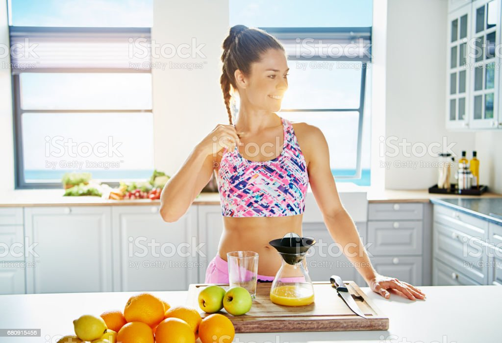 Smiling person doing juice with different fruits royalty-free stock photo