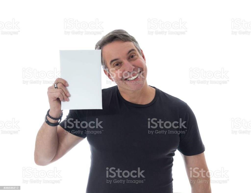 Smiling person holds an advertising poster. Middle-aged gray-haired man is wearing a black T-shirt. Isolated on white background. stock photo