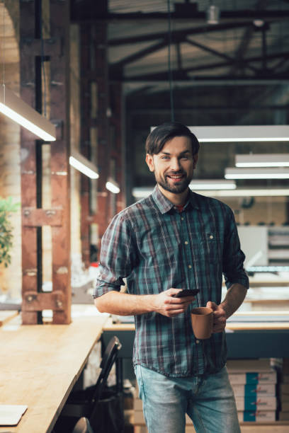 Smiling person looking ready for working day stock photo stock photo