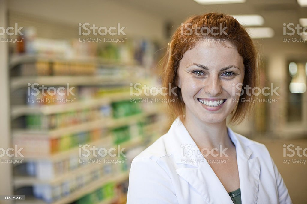 A smiling pharmacy technician in her lab coat stock photo