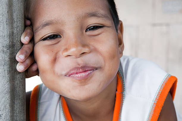 Smiling Philippine boy Portrait of a smiling boy in the Philippines from an impoverished neighborhood. filipino ethnicity stock pictures, royalty-free photos & images