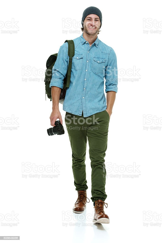 Smiling photographer walking stock photo