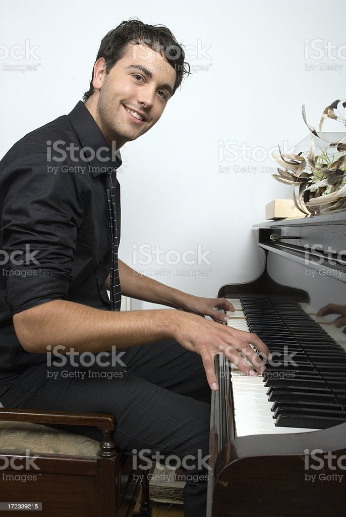 Smiling Piano Man stock photo