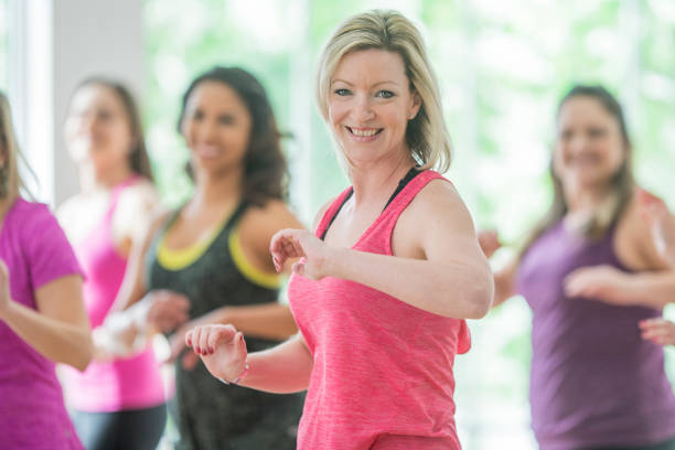 smiling - aerobics stock photos and pictures