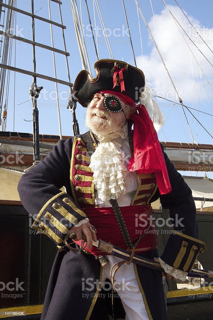 Smiling pirate with sailing ship stock photo