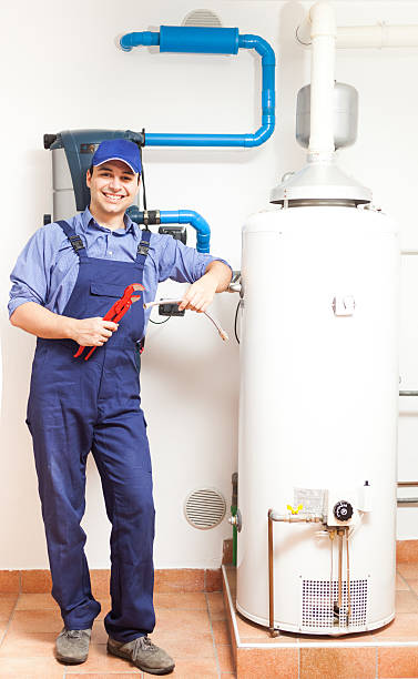 Smiling plumber at work Portrait of a smiling plumber at work pipefitter stock pictures, royalty-free photos & images