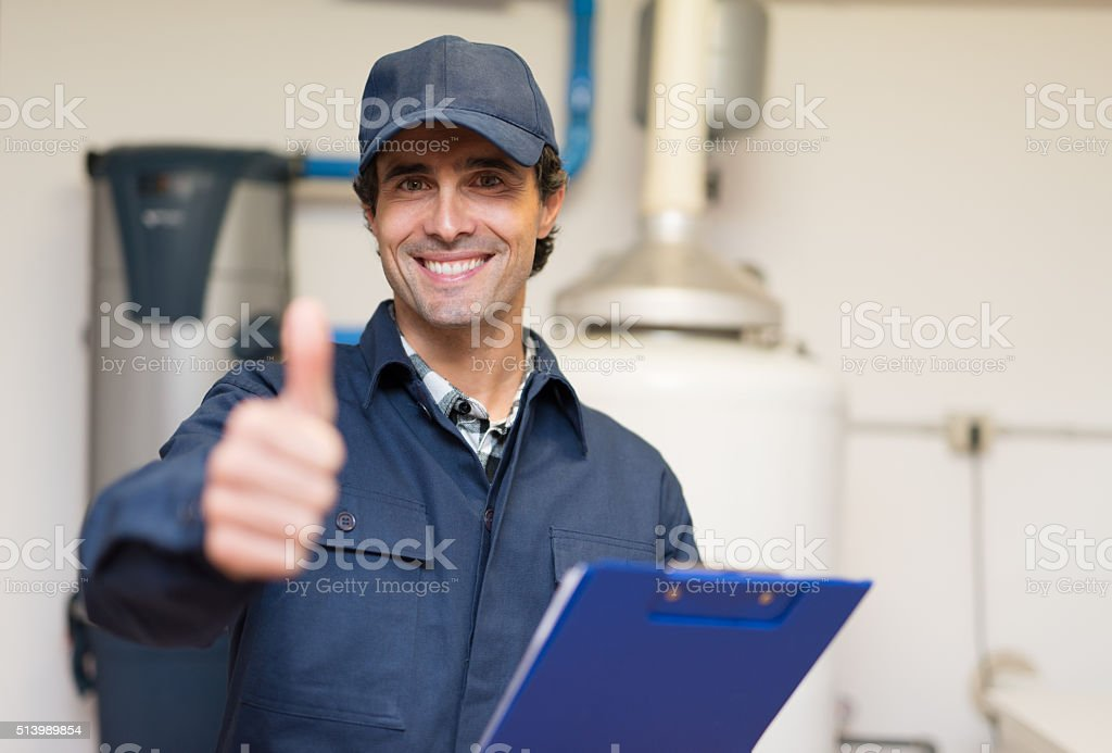 Smiling plumber portrait stock photo