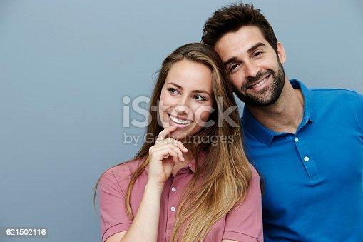 istock Smiling polo shirt couple in studio 621502116