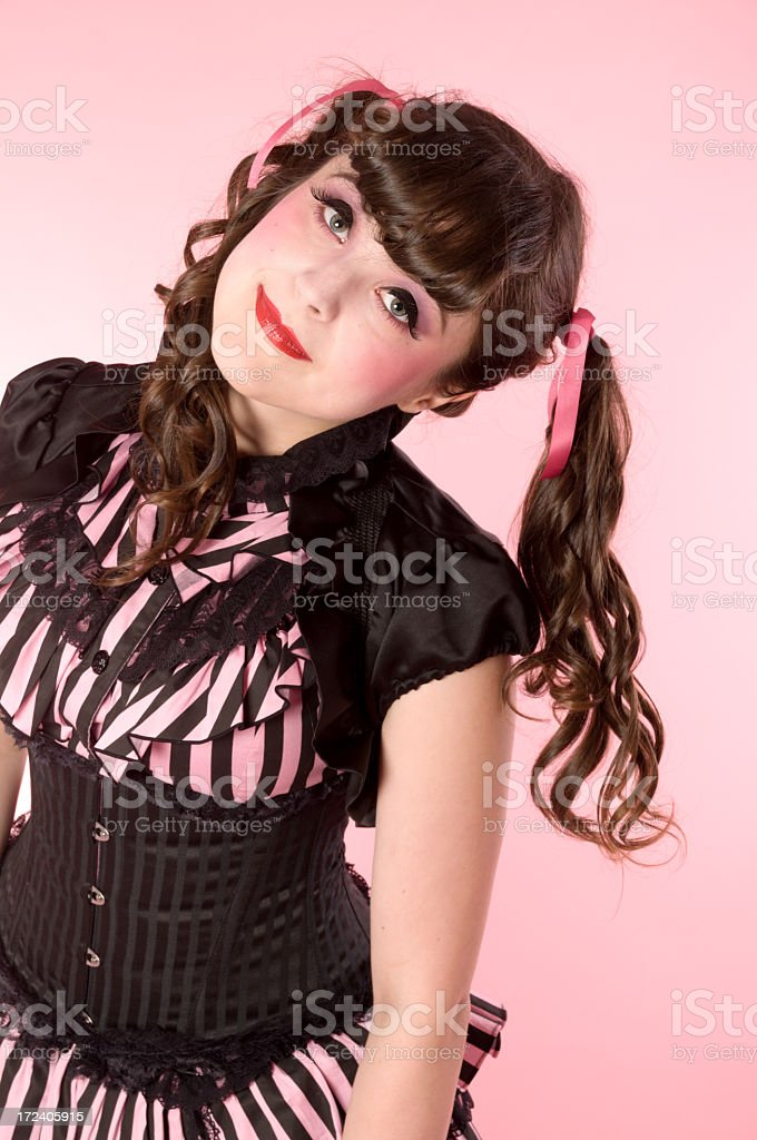 Smiling porcelain doll model with head tilted. royalty-free stock photo
