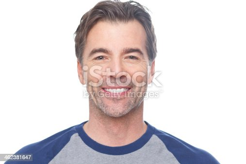 637538262istockphoto Smiling portrait of a man with salt and pepper hair 462381647