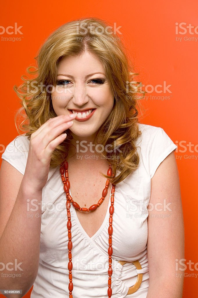 Smiling Portrait With Orange Accents royalty-free stock photo