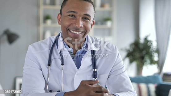 istock Smiling Positive African-American Doctor At Work Looking at Camera 1039473952