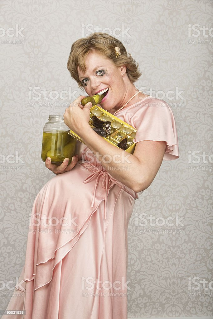 Smiling Pregnant Woman Eating stock photo