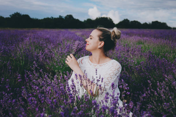 Smiling pregnant woman in lavender field. stock photo
