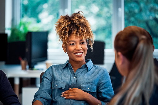 Smiling Pregnant Woman Working In New Office Stock Photo - Download Image Now