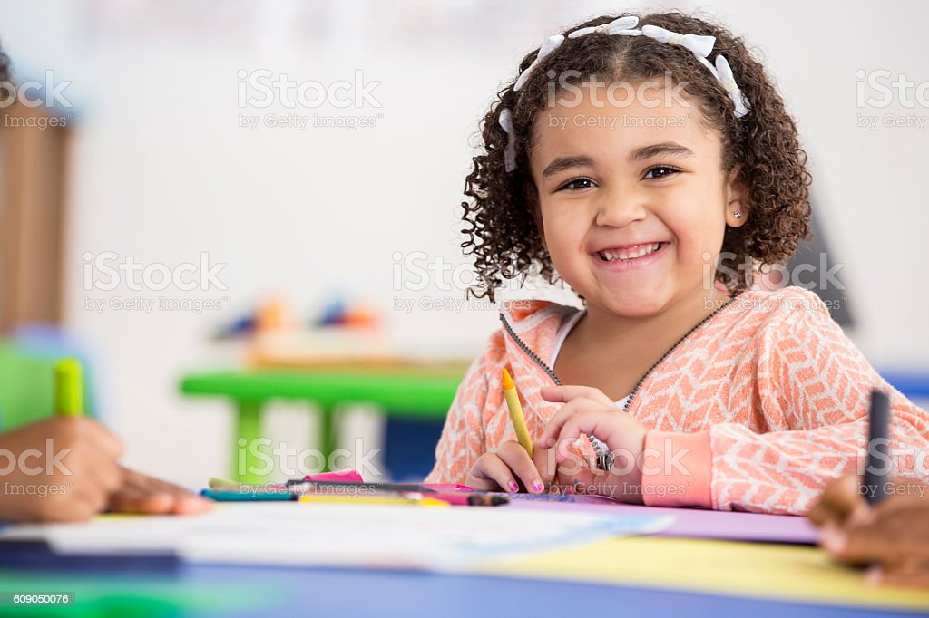 Smiling preschool girl has fun in her class - Photo