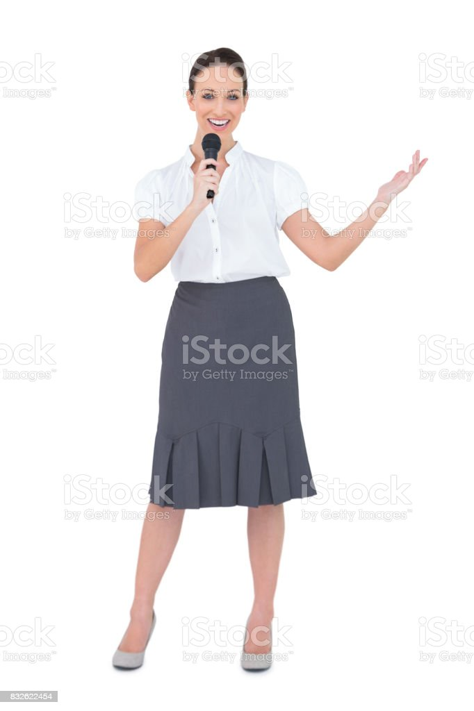 Smiling presenter holding microphone stock photo